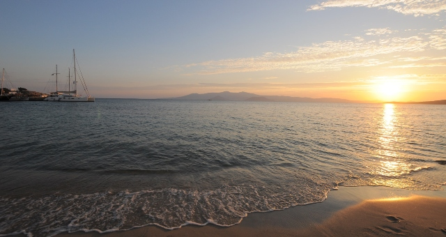 sunset in Naxos, sandy beach and crystal waters, travel to Naxos by ferry, ferry routes