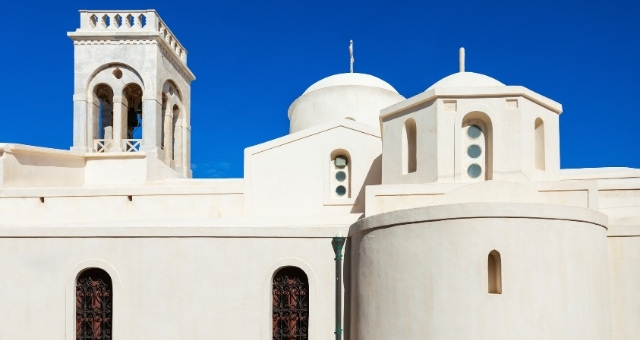 Catholic church, Naxos, castle, cathedral, white walls, blue sky, island architecture