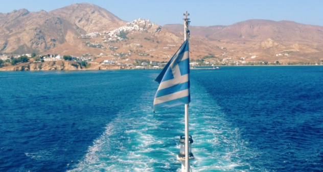 Ferry departing from the port of Naxos, island hopping, blue sea, Greek flag, landscape, ferry tickets
