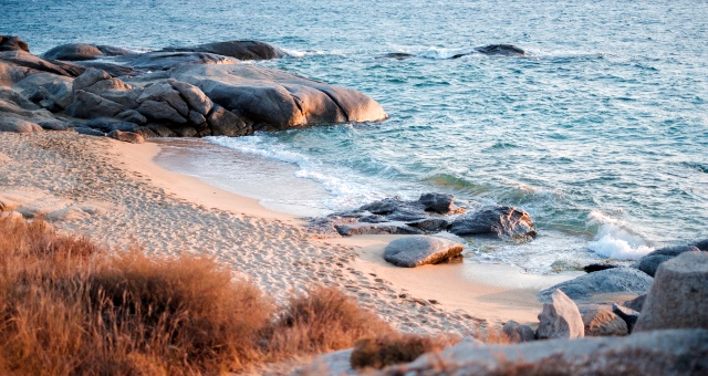 Detail from sand beach in Naxos, relaxing holidays, blue sea, ferry routes in Cyclades