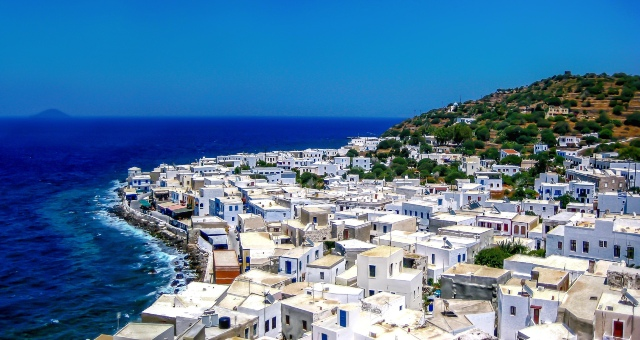 The port of Mandraki in Nisyros, Dodecanese, blue sky, blue sea, white houses, coastline, ferry routes