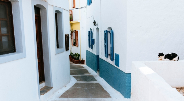 Colourful streets in Mandraki, main town and port of Nisyros, white houses, cats, ferry tickets