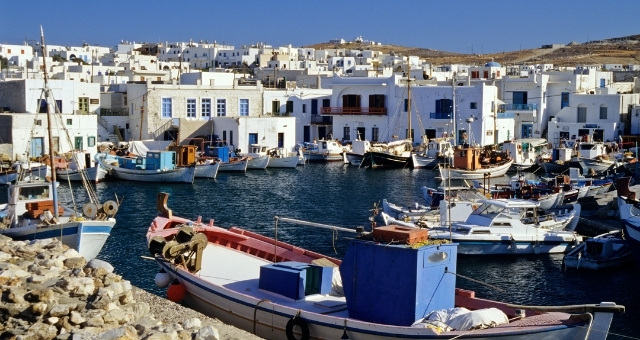 The fishing port of Naousa in Paros, fishing boats, white houses
