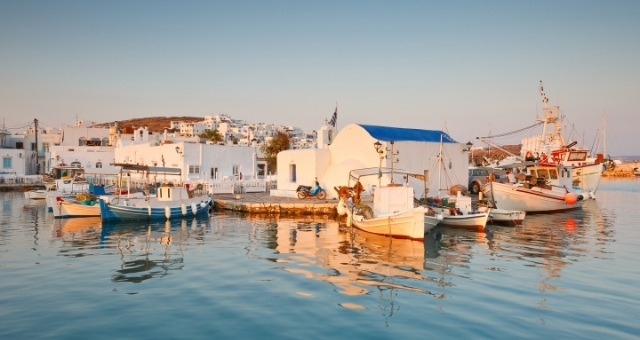 Port of Naousa, coastal village, fishing boats, sunset colours, white houses