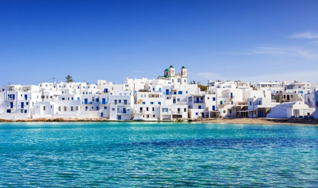 white houses in Paros, crystal sea, blue windows, Naxos to Paros and Crete, ferryhopper