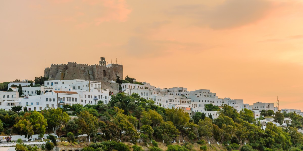 The castle and the white houses of Chora in Patmos at sunset