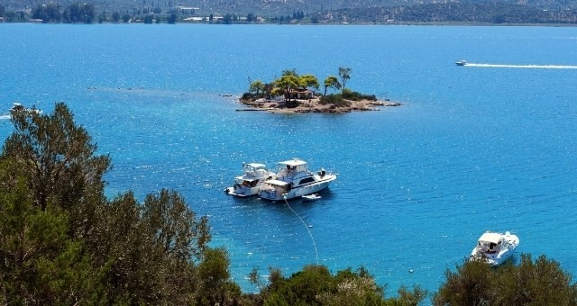 The small green islet of Daskalio in Poros