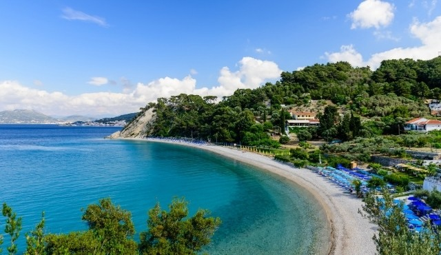 The beautiful beach of Tsamadou in Samos surrounded by trees