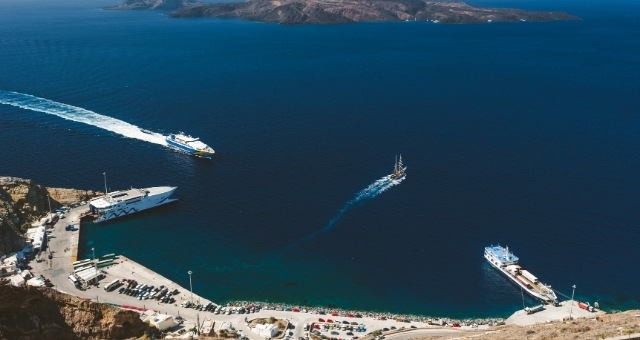 Ferries departing and arriving at the port of Santorini, Athinios, blue sea, Thirassia island