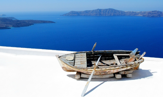 Boat and view of caldera from Santorini