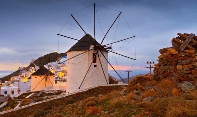 The beautiful windmills of Chora dressed in the sunset light
