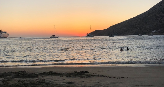 sunset on Kamares beach of Sifnos, sand, sea, boats
