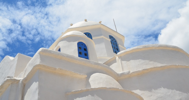 white church in Sifnos, blue windows, summer in the Cyclades, ferry routes