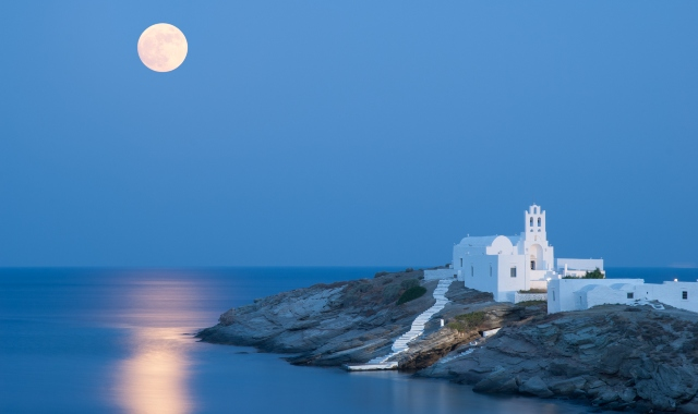 Full moon over a chapel in Sifnos