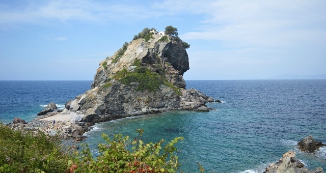 Large rock in a beach in Skopelos, blue sea, clear sky, nature, Sporades islands, ferry routes
