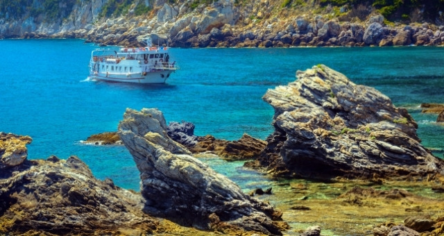 Beach in Skopelos, rocks, cove, passenger boat, blue sea
