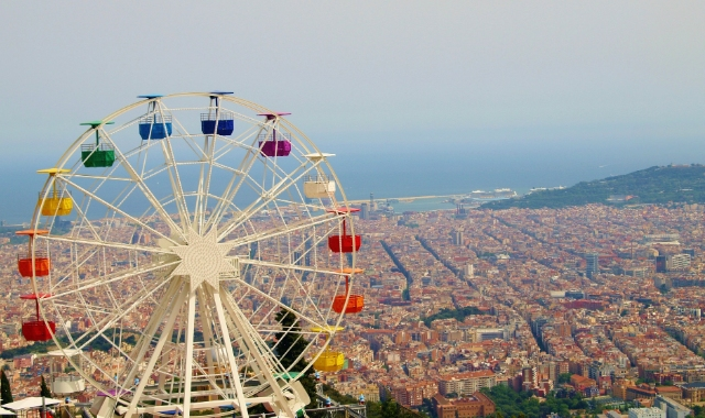 The colors of the rainbow, Ferris wheel, aerial view of Barcelona, Genoa, ferry routes