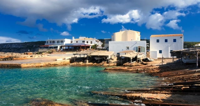San Augusti fishermans' village, white houses, fishing boats, tradition, Formentera coast, blue sky, clouds