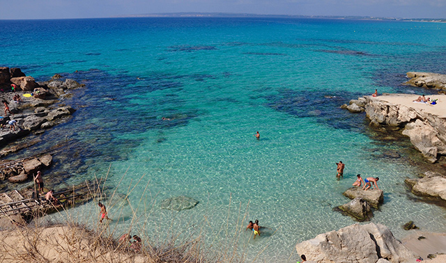 The turquoise waters of the cove of Caló Des Mort in Formentera, Spain
