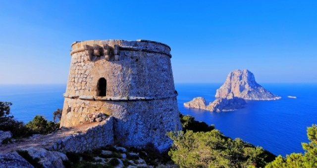 View of Es Vedrà island from the Es Savinar watchtower in Ibiza, Spain