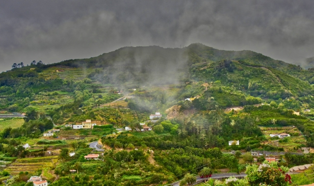 Clouds and fog over the green mountains of La Gomera, Canary Islands, nature, village, holidays, ferry routes