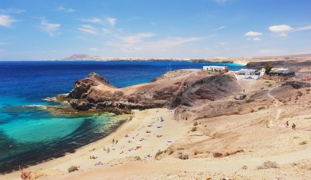 lanzarote, playa de papagayo, exotic beach, sandy coast, crystal-clear waters, rocks, swimmers, canary islands