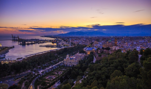 Sunset and nightlife in Malaga, view of the old town and port, ferry routes to north Africa
