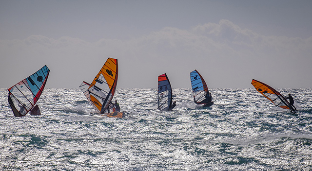 Windsurfing in Tarifa, Andalusia - colour sails, waves, wind, sea - ferry routes to Morocco