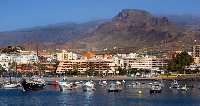 The port and town of Los Cristianos, south Tenerife, sailing boats, mountains, houses, resorts