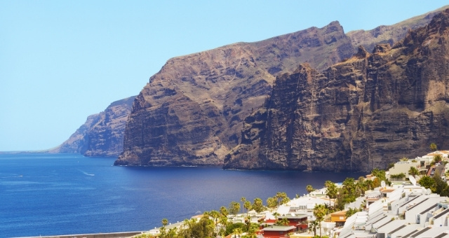 Hotels and resorts in Los Gigantes, Tenerife, mountains, palm trees, sea, Atlantic ocean, view