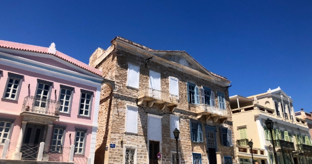 architecture, pink building, stone mansion, holidays in Syros, compare prices