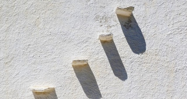 white wall and stones in Syros