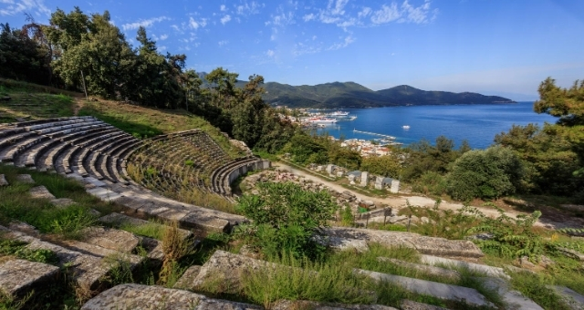 The ancient theatre of Thassos with a sea view, surrounded by lush greenery