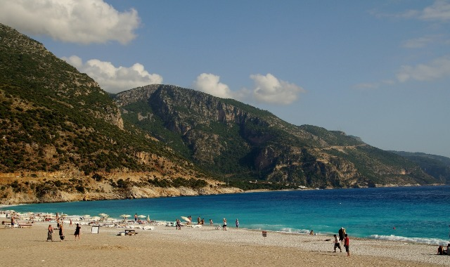 sandy beach, mountains, blue sea, swimmers, umbrellas, Marmaris, ferry route to Turkey