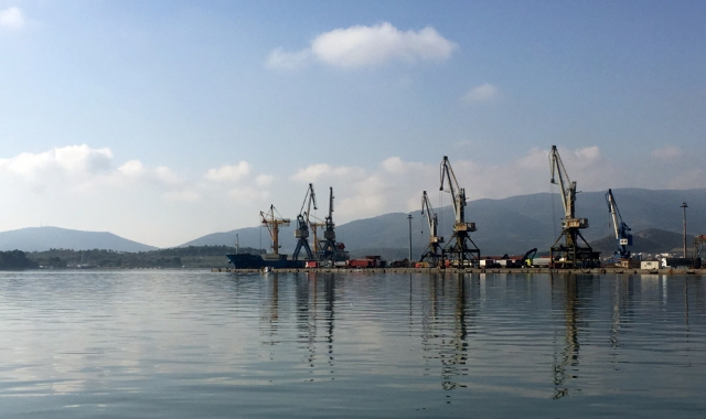 Cranes and buildings reflection at the port of Volos, ferry routes to Skiathos, Skopelos, Alonissos