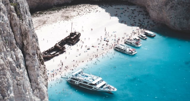 The famous beach of Navagio, shipwreck, visitors, sandy beach, blue sea, ferry routes, tickets
